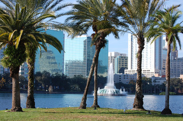 Orlando, Florida. Lake Eola and palm trees in foreground.