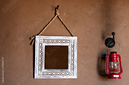 mirror lantern on mud wall
