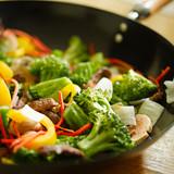 wok stir fry closeup with selective focus