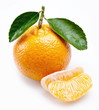 Image of a ripe tangerine with leaves on white background.