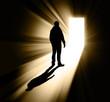 silhouette of man in doorway