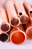 Set of copper pipes of different diameter lying in one heap poster