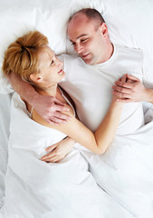 Woman and man lying in the bed together