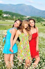 girls in daisy field