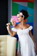 Curious bride with a wedding bouquet