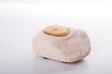 Kerze im Stein