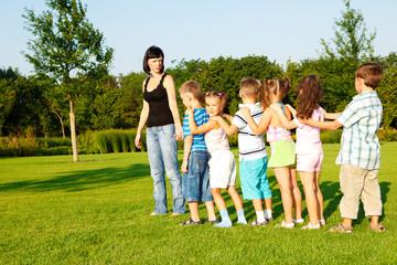 Preschool boys and girls with teacher