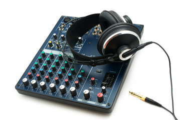 Mixing console and headphones.