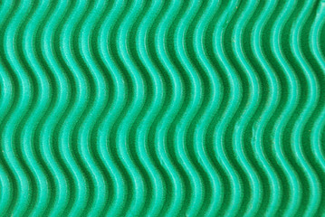 Background with wavy green cardboard