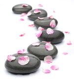 Fototapety Spa stones with rose petals on white background.
