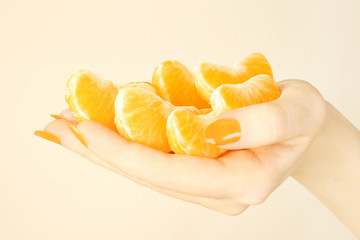 Hand with tangerine.