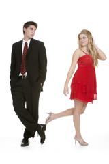 Attractive teenage girl walking away from teenage boy
