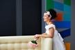 Joyful bride with a wedding bouquet