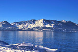 Beautiful snow capped mountains and Lake Tahoe poster