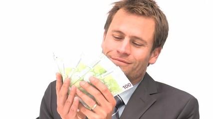 Businessman smelling euro notes