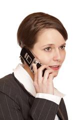 Junge attraktive Frau telefoniert  am Telefon