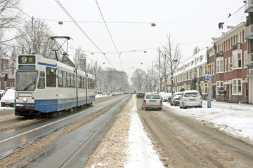 Tram driving in Amsterdam the Netherlands in winter
