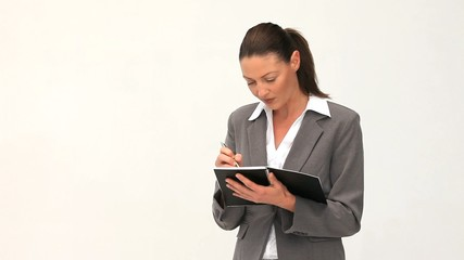 Businesswoman writing on her notebok