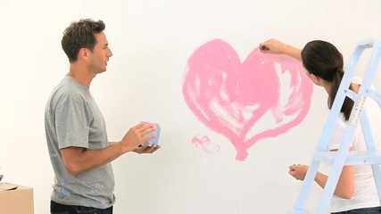 Happy couple painting together