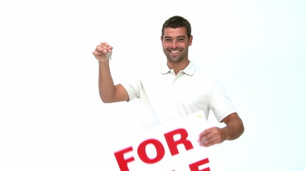 Man showing a for sale board