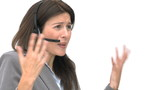 Angry businesswoman talking with headphones