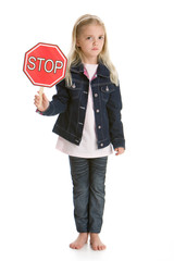 Cute little girl holding a red stop sign