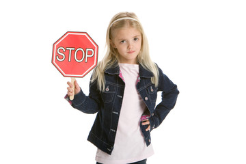 Cute little girl holding a stop sign on white background