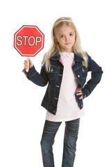 Pretty little girl holding a stop sign