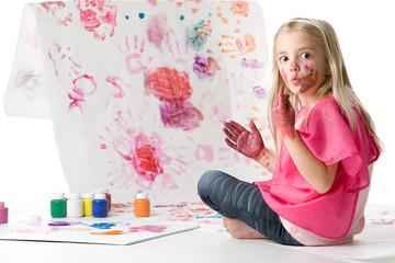 Cute little girl finger painting