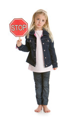 Cute little girl holding a stop sign, with a sad face