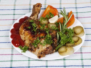 chicken with garnish on a plate