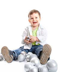 A lovely baby is playing with balls
