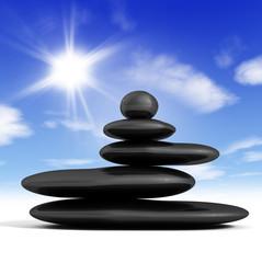 concepto zen con piedras en equilibrio y fondo de cielo azul