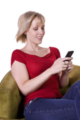 Beautiful Woman Texting on the Couch