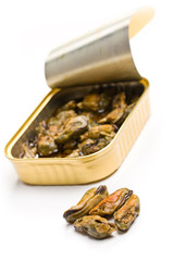 smoked mussels in opened tin can