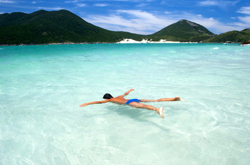 Swimming in crystalline clear waters in Arraial do Cabo