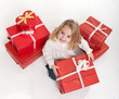 Little girl opening her presents