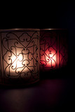 Stylized candles with light of hope in the darkness