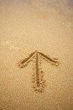 Arrow in beach sand