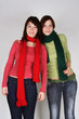 portrait of two young girls in green and red scarfs