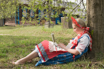 girl with a laptop in a rural landscape