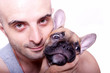 Little french bulldog puppy with a guy