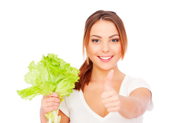 young woman holding green lettuce