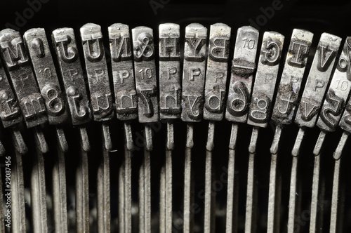 Close-up of typewriter letter and symbol keys - 29087456