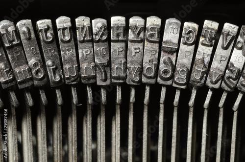 Close-up of typewriter letter and symbol keys - 29087456