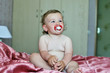 funny baby girl with soother