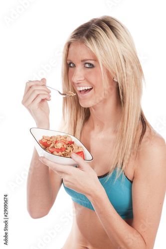 Woman fitness eating cereal