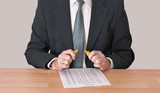 Businessman with snapped pencil - stress concept poster