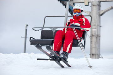 Female skier on chair-lift