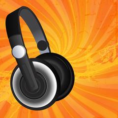 Black headphones on grunge background
